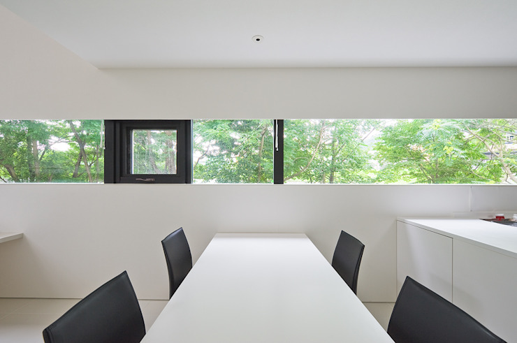 Modern dining room by 株式会社コウド一級建築士事務所 Modern