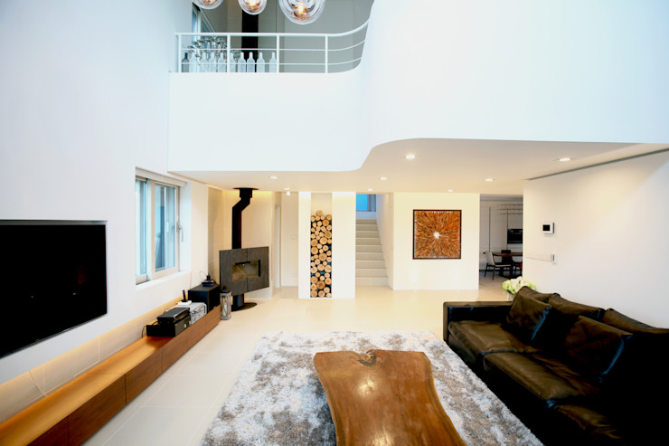 Living room by HBA-rchitects,