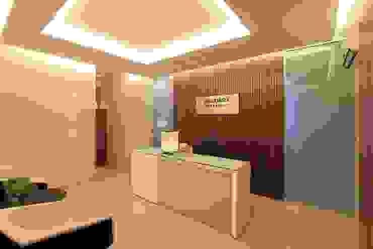 Sala de Espera Lojas & Imóveis comerciais ecléticos por Camila Tannous Arquitetura & Interiores Eclético