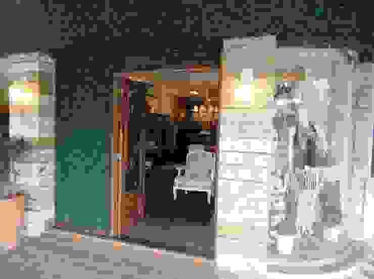 Loja Acaica Lojas & Imóveis comerciais ecléticos por Gabriela Herde Arquitetura & Design Eclético
