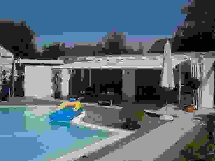 Mester Fenster-Rollladen-Markisen Mediterranean style balcony, porch & terrace