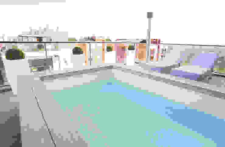 Como decorar mi casa para ganar luz Balcones y terrazas de estilo moderno de Estatiba construcción, decoración y reformas en Ibiza y Valencia Moderno