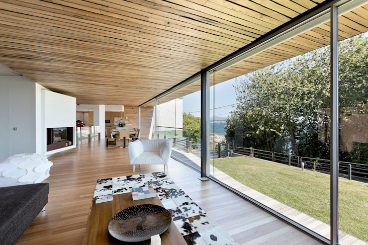 dezanove house designed by iñaki leite - living interior od Inaki Leite Design Ltd. Nowoczesny