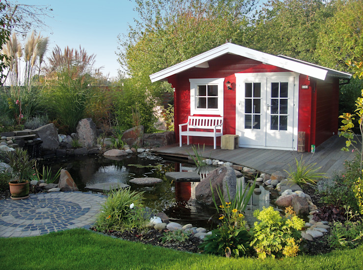 http://www.gardenaffairs.co.uk/our-ranges/log-cabins/ homify Giardino rurale