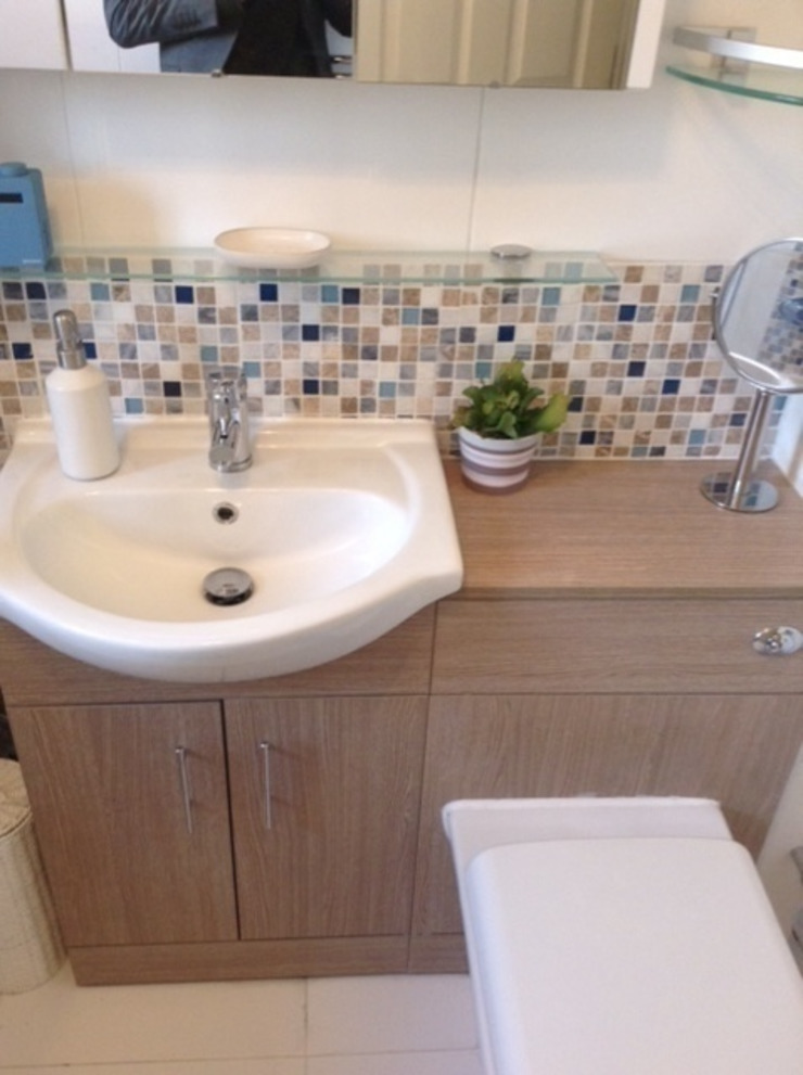 White bathroom at Royal Victoria Docks London E16 by Design Inspired Ltd