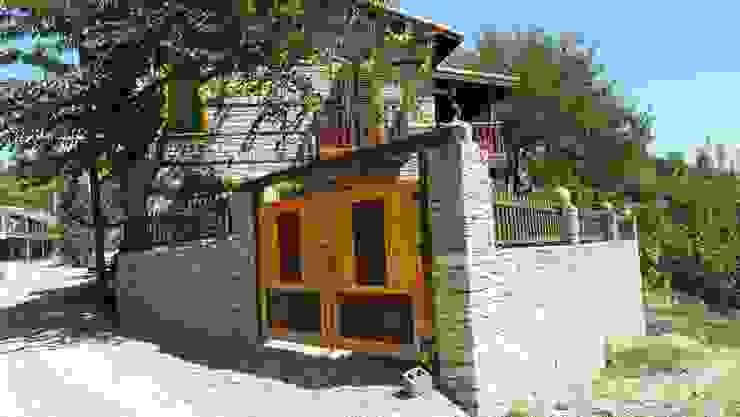 Doğal taş ev ve doğal taşlar ile bahçe duvarı Tropikal Evler Kayalar İnşaat Ltd şti. Tropikal