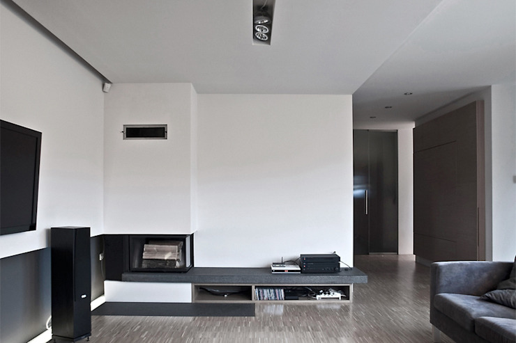 Salas de estar modernas por Konrad Idaszewski Architekt Moderno