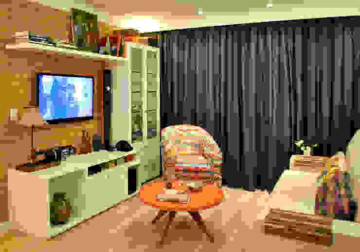 Sala tijolinhos: Salas de estar  por Red Studio