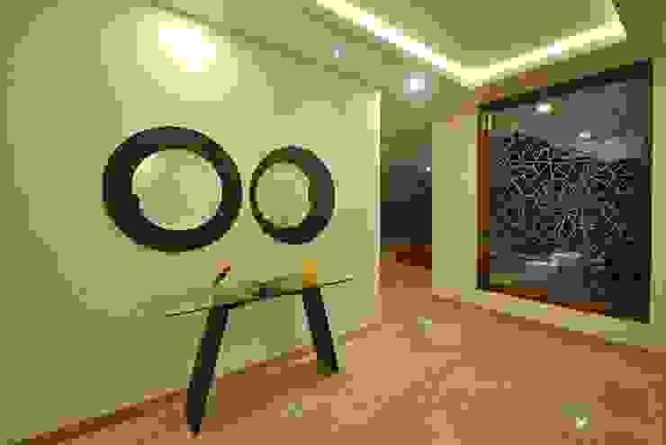 Mr & Mrs Pannerselvam's Residence Modern living room by Muraliarchitects Modern