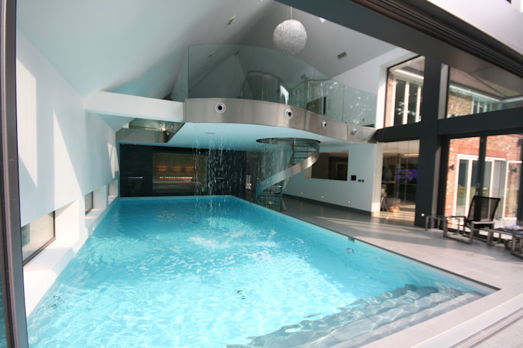 Indoor pool with waterfall features, sauna and stainless steel spa Tanby Pools Modern pool