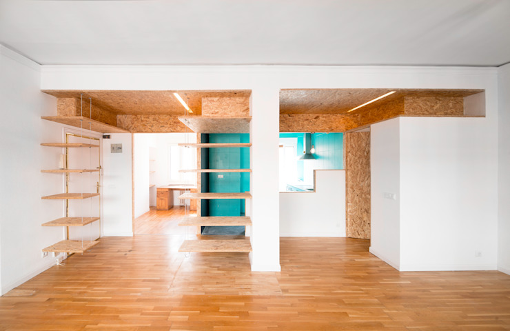 Reforma Low-Cost Salones de estilo industrial de idearch studio Industrial