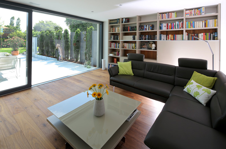Villa mit Pool Moderne Wohnzimmer von Unica Architektur AG Modern