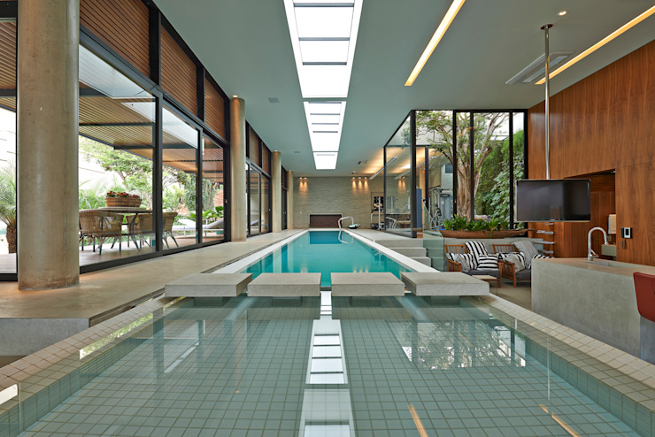 Modern pool by Beth Nejm Modern