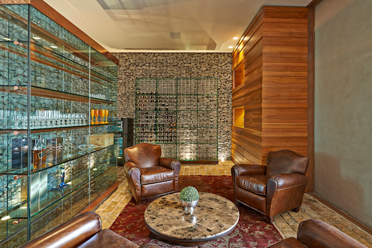 Modern wine cellar by Beth Nejm Modern