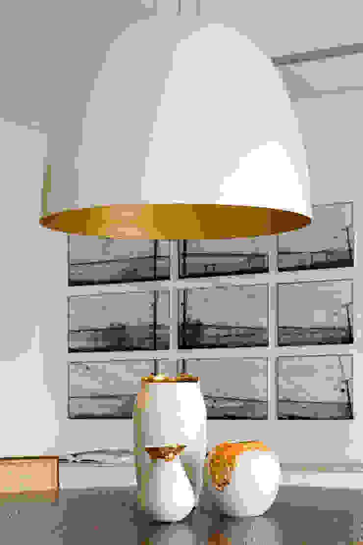 Panamby Apartment DIEGO REVOLLO ARQUITETURA S/S LTDA. Salas de jantar modernas