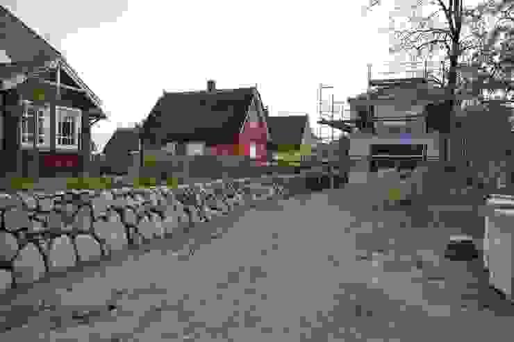 Westseite: modern  von Haus Wieckin,Modern