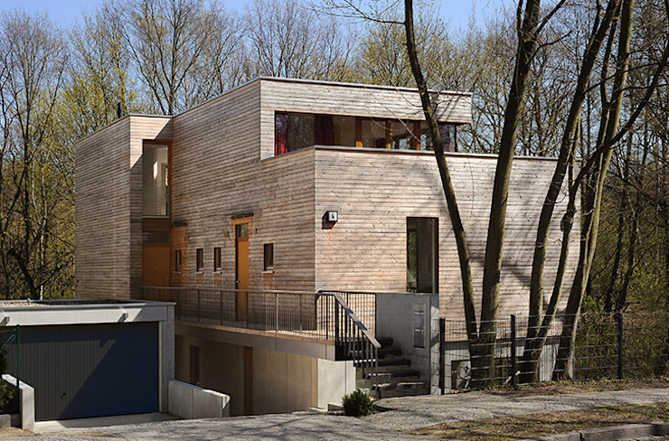 Houses by Carlos Zwick Architekten, Modern