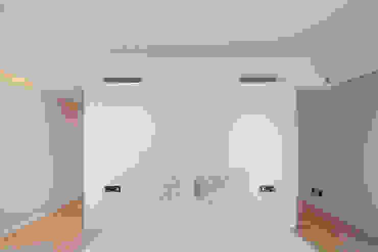 Dormitorios de estilo  de Estúdio Urbano Arquitectos ,