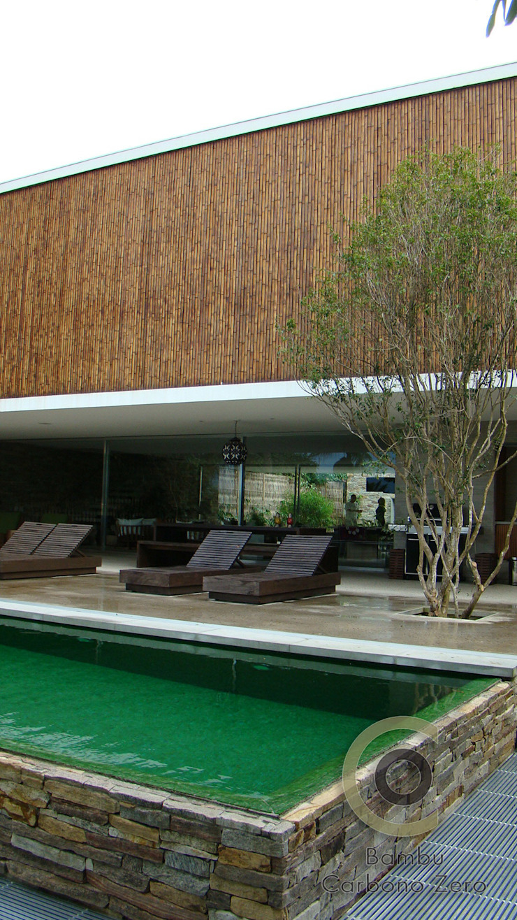 Casa Ilha Bela Márcio Kogan Corredores, halls e escadas tropicais por BAMBU CARBONO ZERO Tropical