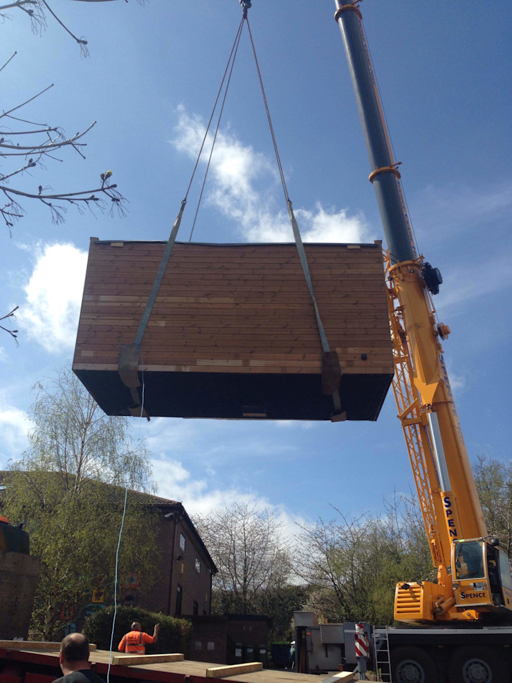 Craned into site. Modern schools by Building With Frames Modern