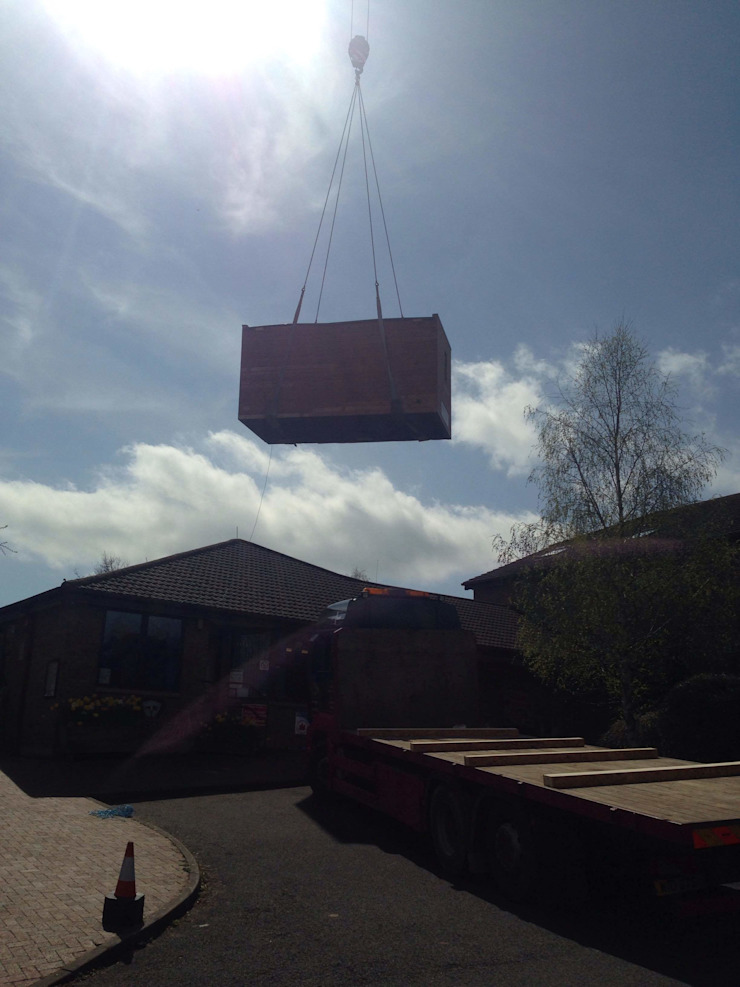 Craned into position. Modern schools by Building With Frames Modern