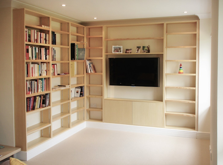 Contemporary ash Bookcases with media center by Built in Solutions