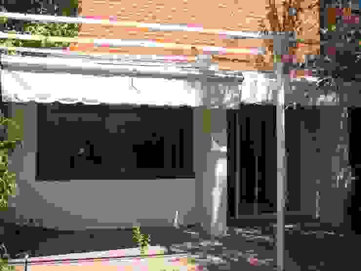 REFORMA VIVIENDA UNIFAMILIAR ADOSADA. EL SOTO DE LA MORALEJA. MADRID. 2007 de Bescos-Nicoletti Arquitectos