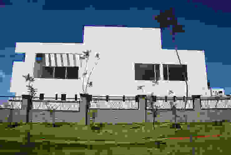 Houses by [TT ARQUITECTOS], Modern