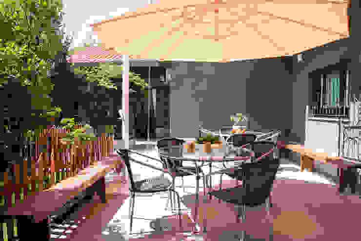 Giardino tropicale di Marcos Contrera Arquitetura & Interiores Tropicale