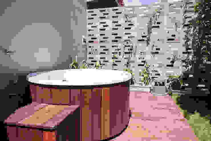 Residencia de Surfista: Spas  por Marcos Contrera Arquitetura & Interiores