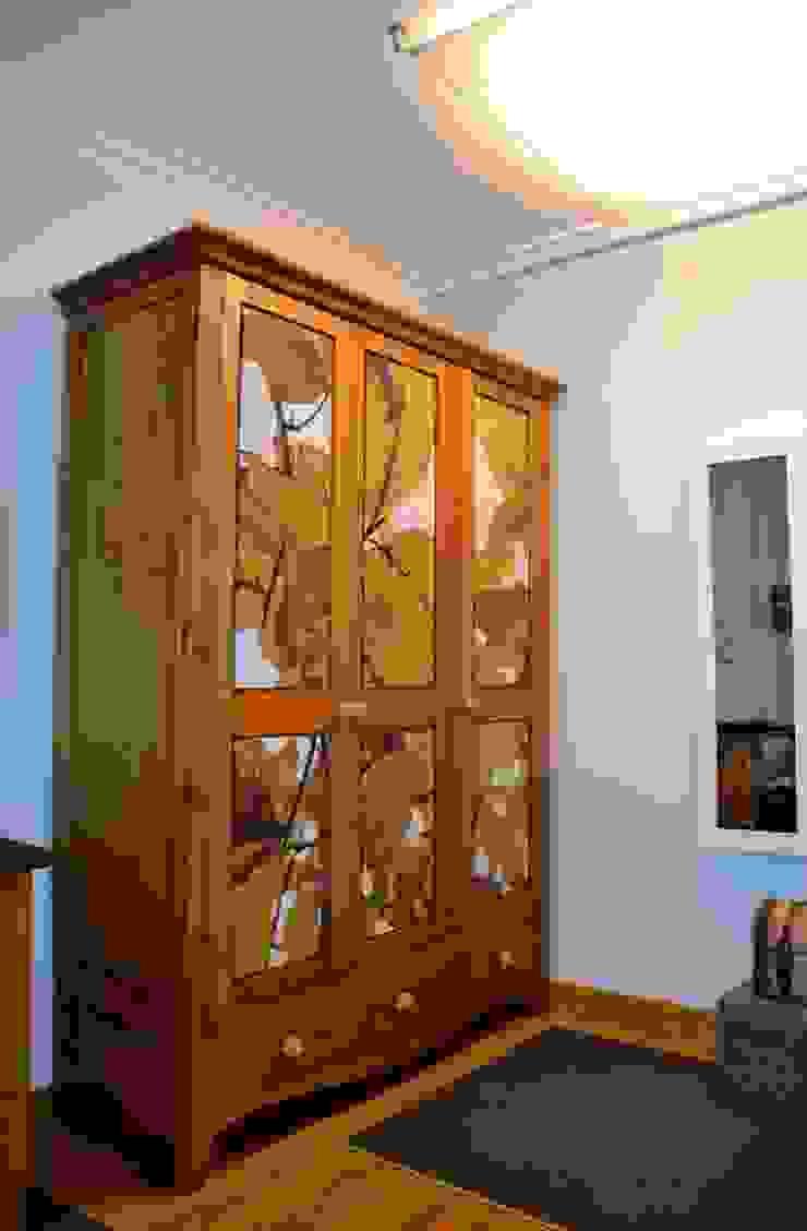 UN PEQUEÑO VESTIDOR Dormitorios de estilo ecléctico de DEINDE Interiorismo Ecléctico