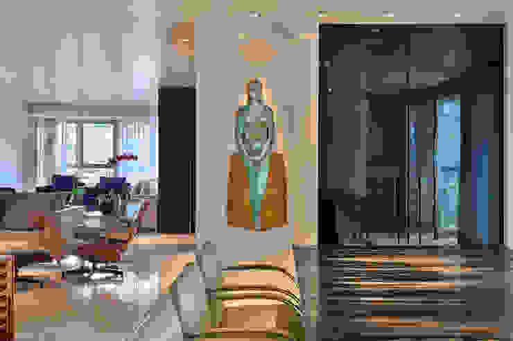 Integração entre as salas de jantar e estar Salas de jantar modernas por Fernanda Sperb Arquitetura e interiores Moderno