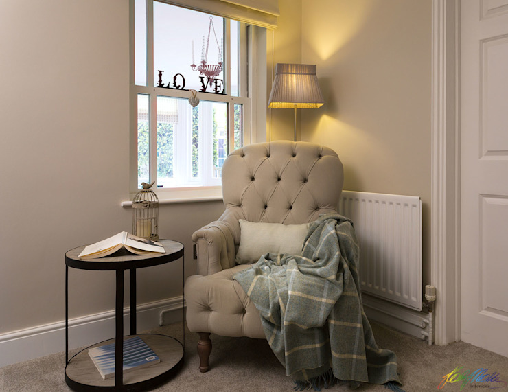 Reading corner with cozy armchair by Katie Malik Interiors Classic