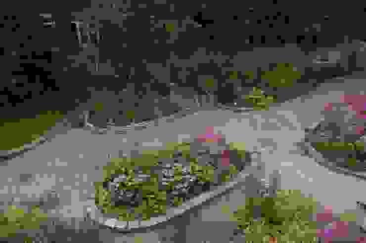 Tuin gezien van dakterras Klassieke tuinen van Gunneweg & Burg Klassiek