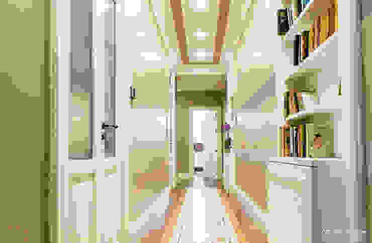 Casa privata BARI. QUARTIERE MURAT, Palazzo primi anni '20. Pareti & Pavimenti in stile classico di Azzurra Garzone architetto Classico