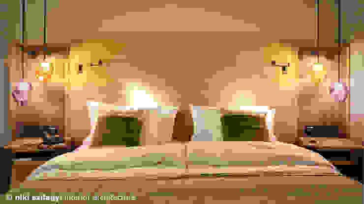 Arabella Alpen Resort & Spa Hotel von niki szilagyi interior architecture Rustikal