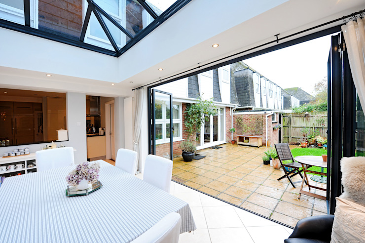 Orangery from kitchen with bi folding doors Modern conservatory by homify Modern