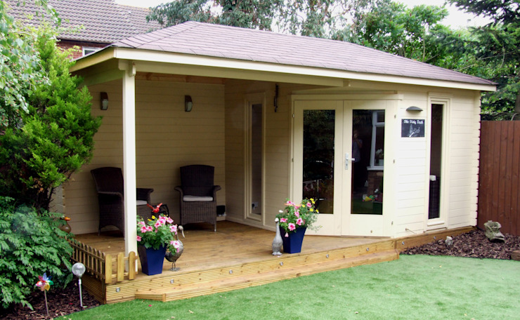 ​Highgrove Cabin 40 mm timber 576cm x300 cm. constructed on decking by The Gazebo Company Modern