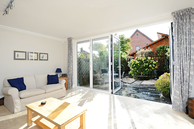Bi Folds fitting into townhouse Modern Windows and Doors by ROCOCO Modern
