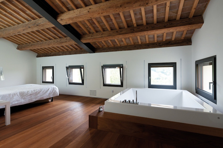 Casa G+S+R+C di Caprioglio Architects Moderno