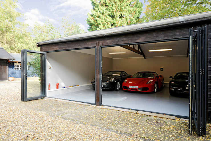 Garage conversion for luxury cars Modern garage/shed by ROCOCO Modern