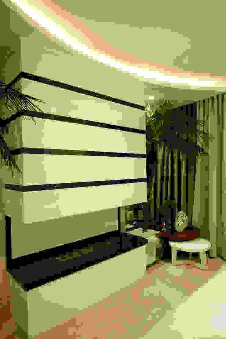 Casa Parque por Designer de Interiores e Paisagista Iara Kílaris Moderno