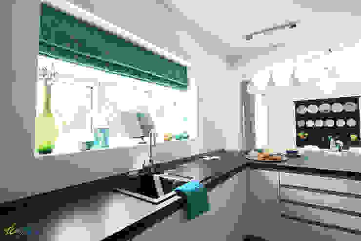 Kitchen area-window treatment:  Kitchen by Katie Malik Interiors,