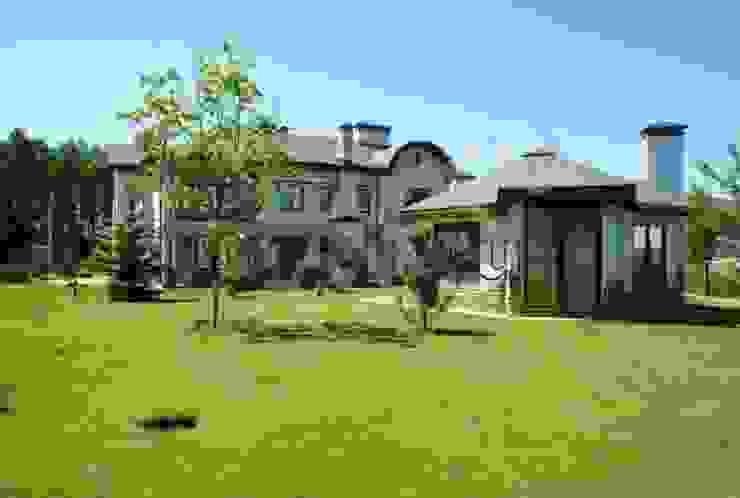 Загородный дом Дома в эклектичном стиле от Архитектурно строительная компания Внутренний мир Эклектичный