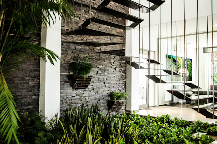 ห้องโถงทางเดินและบันไดสมัยใหม่ โดย ARKOT arquitectura + construcción โมเดิร์น
