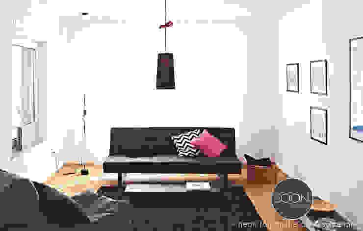 Minimalistyczny salon od Architekturbüro Götz Oertel Minimalistyczny