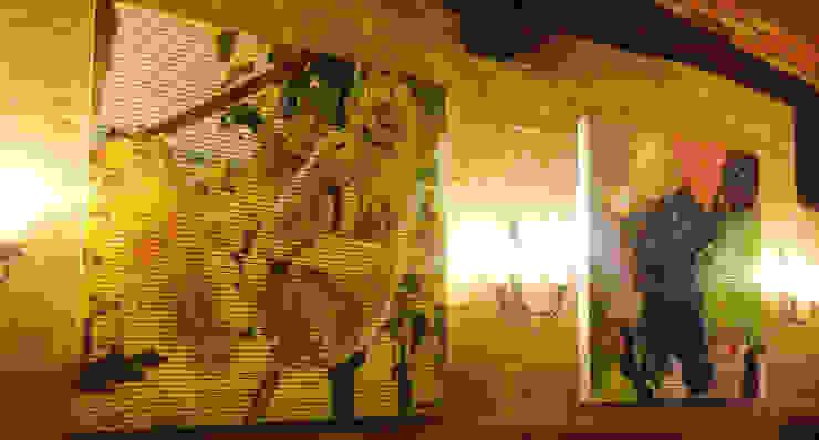 Acondicionamiento acústico con paneles de madera fonoabsorbente que se cuelgan como cuadros Estudios y despachos de estilo moderno de SPIGOGROUP Moderno