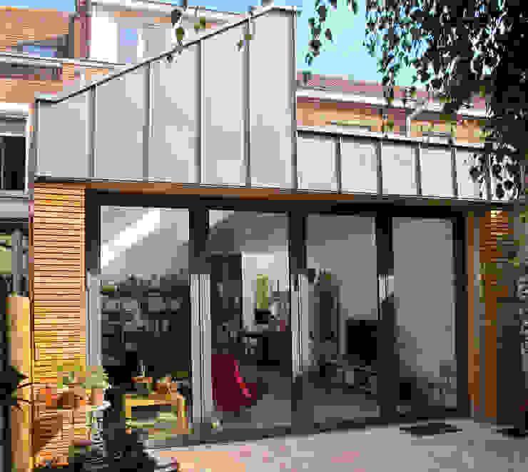 Extension et aménagement d'une maison de ville Maisons modernes par F. DEMAGNY ARCHITECTE Moderne