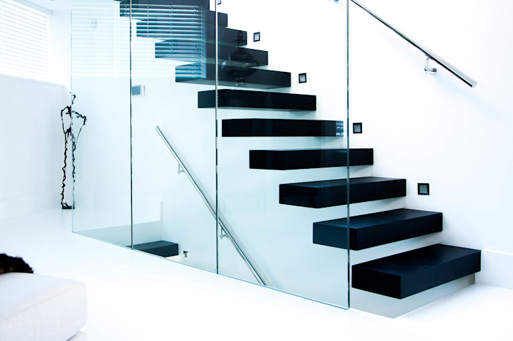 Classic and minimalistic Floating Stairs with black steps Modern Corridor, Hallway and Staircase by Railing London Ltd Modern