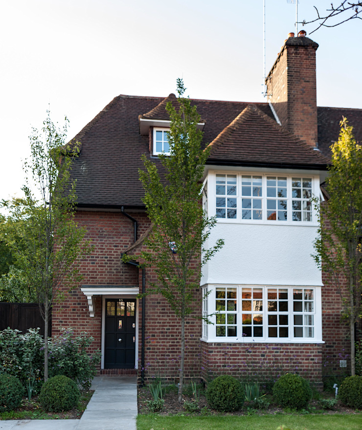 Rotherwick Road—Hampstead Garden Suburbs 'Arts & Crafts' House Modern houses by TG Studio Modern